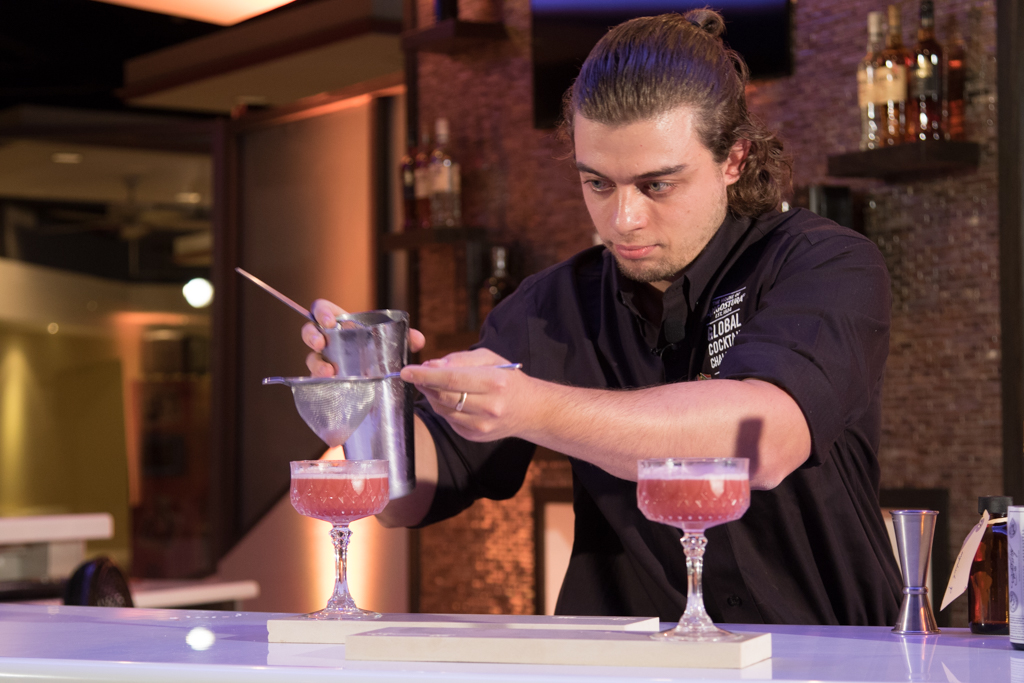 "Dino puts the finishing touches on his winning Rum Cocktail, ""The Sanctuary""."